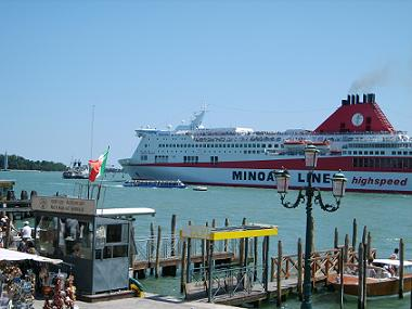Ferry boat sails along St Mark's Square